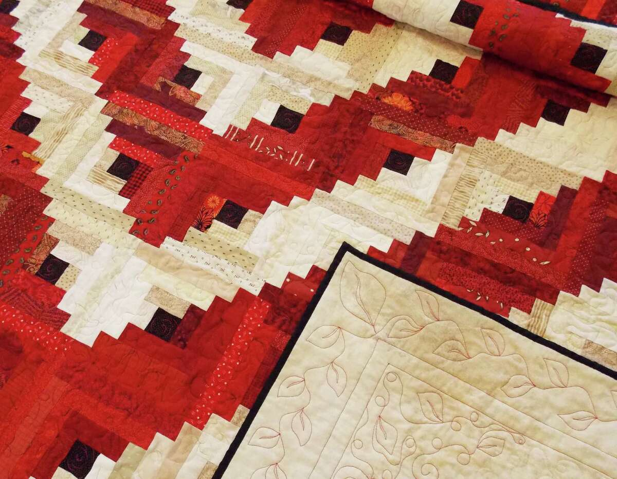 The Kent Quilters will present a log cabin quilt to the Kent Memorial Library at a Saturday, May 2 reception at the Main Street (Route 7) library. Courtesy of the Kent Quilters