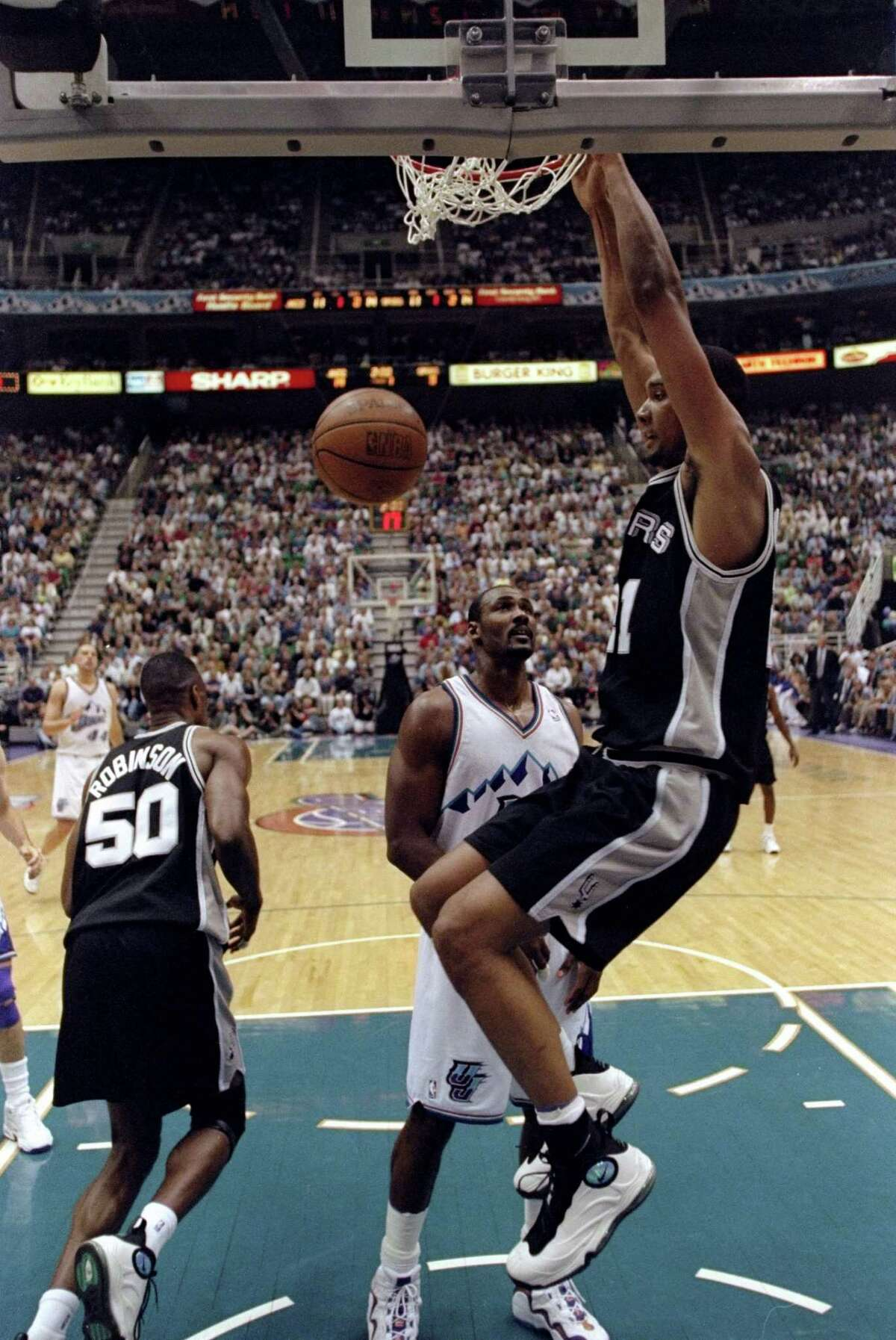 In May 1998, during game 5 of the Western Conference Semifinals, Tim Duncan and David Robinson wore the Nike Total Air Foamposite Max.