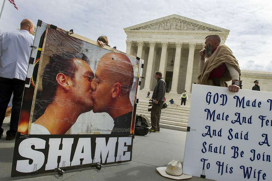Opponents of same-sex marriage demonstrate in front of the Supreme Court in Washington. Photo: Cliff Owen, Associated Press