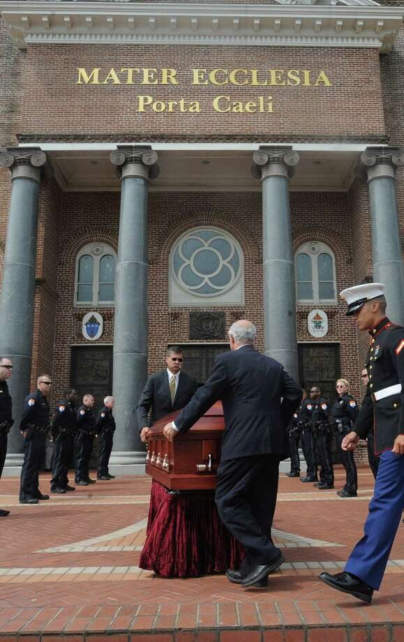 Judge G.R. Lupe Flores' casket is guided into the St. Anthony Cathedral Basilica Monday morning. The 65 year-old judge was the first Hispanic to sit at a judges bench in Jefferson County.  Photo taken Monday, April 27, 2015 Guiseppe Barranco/The Enterprise Photo: Guiseppe Barranco, Photo Editor