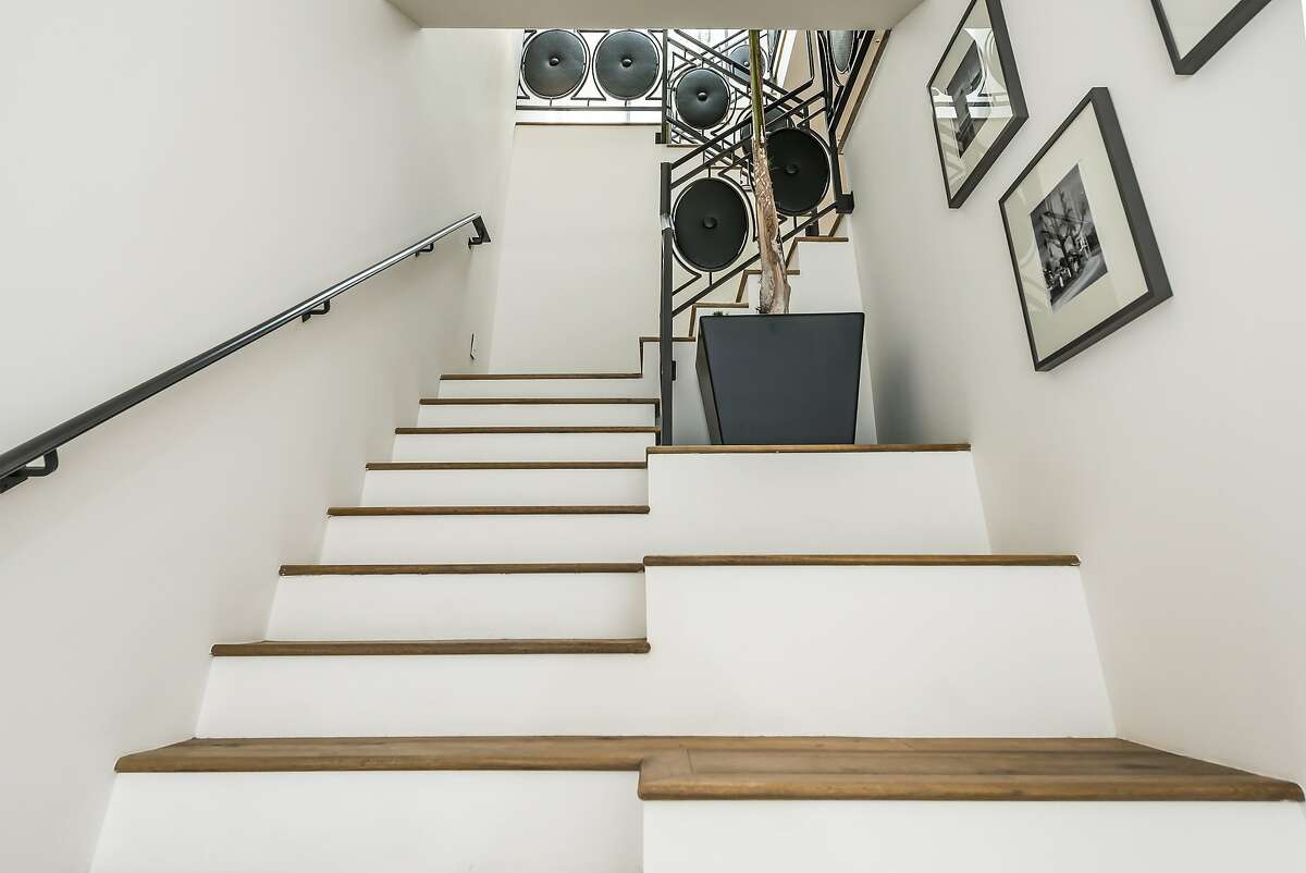 The entryway includes a staircase with wide steps for sitting and putting on shoes.
