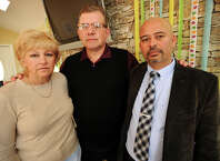 From left; Pam and Carl Stenger, of Beacon Falls, whose daughter Kristin and family work as missionaries in Nepal, and Nepal native Pramod Kandel, of Shelton, at Kandel's Baingan Restaurant in Shelton, Conn. on Monday, April 27, 2015. All are concerned after a 7.9 magnitude earthquake rocked the country on Saturday.