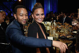 Recording artist John Legend (L) and model Chrissy Teigen attend The 42nd Annual Daytime Emmy Awards at Warner Bros. Studios on April 26, 2015 in Burbank, California.  (Photo by Michael Buckner/Getty Images for NATAS)