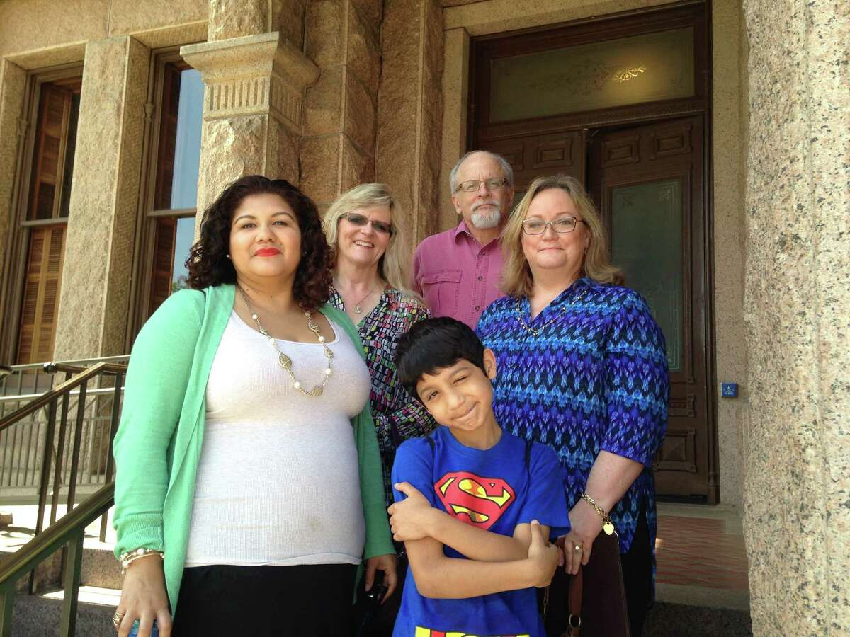 Parents of transgender children (from left) Teresa Gonzales, Lisa Mauldin, Mitchel Roth and Ann Elder gather outside of the Texas Capitol in Austin on August 27, 2015. Joaquin (center), 8, is the son of Gonzales, who also has a 10-year-old transgender daughter, Sammy (not shown).