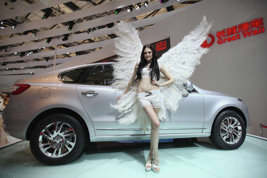 A model poses beside a Great Wall Hover 1F car during the media day of the Shanghai International Automobile Industry Exhibition at Shanghai New International Expo Center on April 20, 2011 in Shanghai, China. Photo: Feng Li, Getty Images / 2011 Getty Images