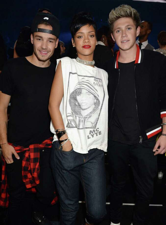 Rihanna schools Liam Payne and Niall Horan of One Direction with an old-school MC Lyte shirt. Photo: Jeff Kravitz, Getty Images / 2013 Jeff Kravitz