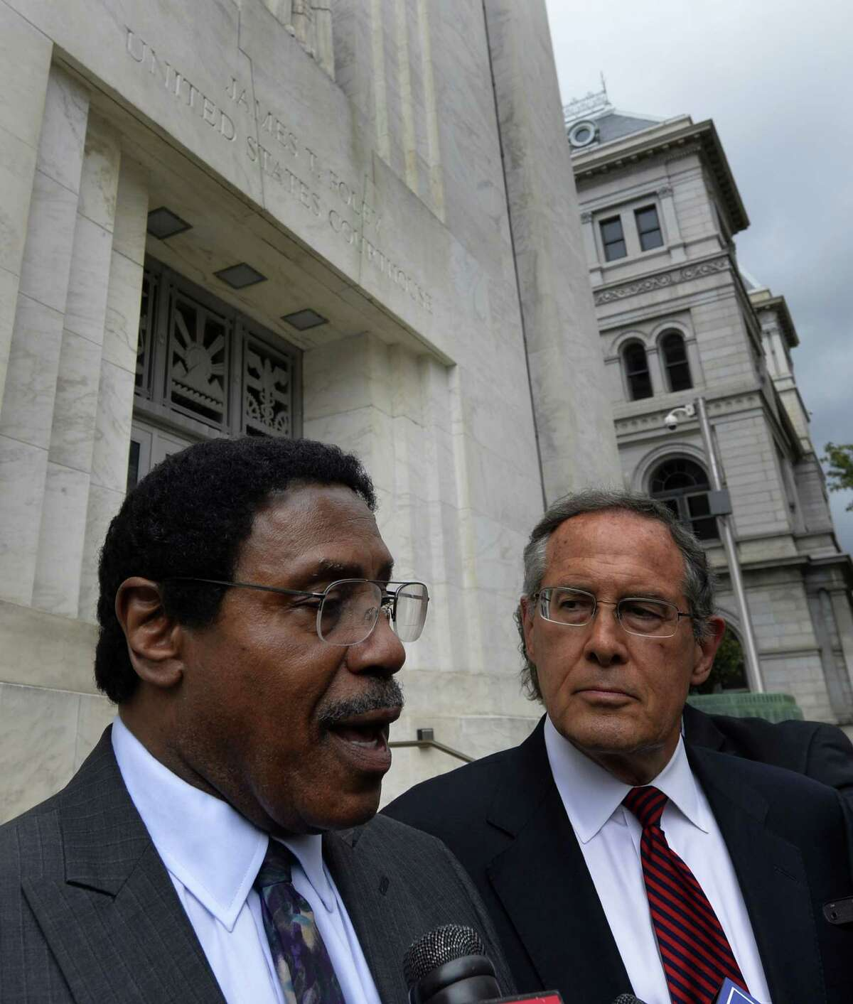 Assemblyman William Scarborough speaks to the media under the supervision of his attorney E. Stewart Jones, right, after his appearance in Federal Court Wednesday afternoon, Oct. 1, 2014, in Albany, N.Y. (Skip Dickstein/Times Union archive)