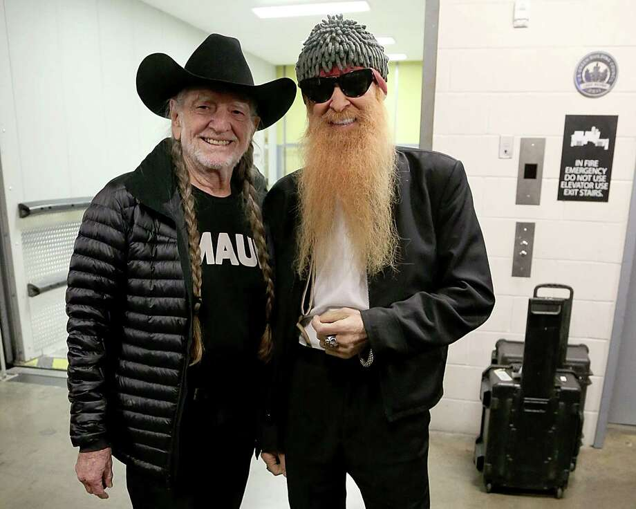 PHOTOS: 84 pictures of Willie Nelson with all his famous friendsWillie is a popular guy and his easy-going demeanor blends just as well with Billy Gibbons (from  ZZ Top, pictured) as it does with politicians and Hollywood stars like Zooey Deschanel.Click through to see all the people who have crossed paths with the Red Headed Stranger.... Photo: Gary Miller, File / Getty / 2014 Gary Miller