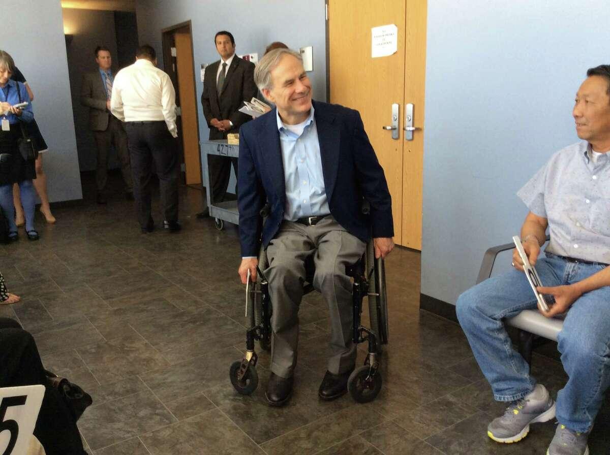 Texas Gov. Greg Abbott reports for jury duty in Austin on Monday, April 27, 2015.