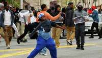 Latest on police-custody death: Marchers take to streets - Photo