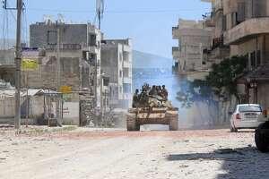 Syrian insurgents capture military base - Photo