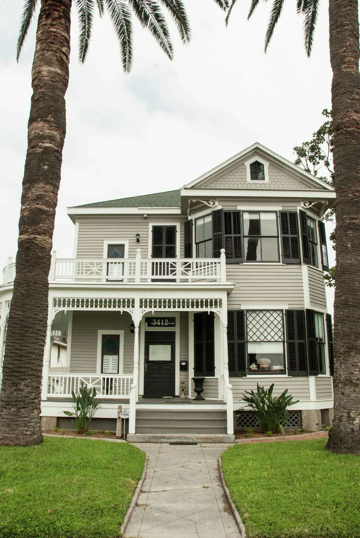 New paint and repaired gingerbread detailing made this 1909 home on Galveston's Avenue O look fresh again.