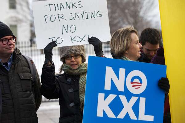 "Yvette Torell, left, with 350.org, holds up a sign that says ""Thank for Saying No to KXL"", next to Melinda Pierce, right, of the Sierra Club, as they join other opponents of Keystone XL to celebrate President Barack Obama's veto of the legislation outside the White House in Washington, Tuesday, Feb. 24, 2015, (AP Photo/Jacquelyn Martin)"