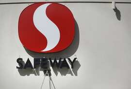 A New York investment firm called Cerberus bought the grocery chain for $9 billion, a Safeway sign invites customers to the store on Market and Church Streets on Friday March 7, 2014 in San Francisco.
