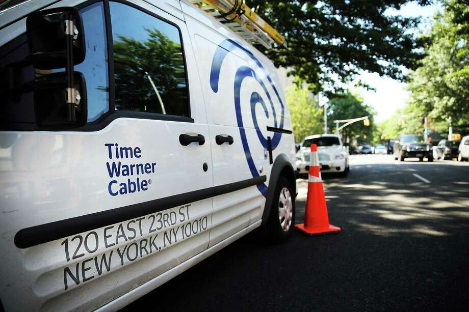 FILE - APRIL 23:  According to reports, Comcast is ending its $45 billion dollar bid to takeover Time Warner Cable, April 23, 2015. NEW YORK, NY - AUGUST 27:  A Time Warner Cable truck is viewed in Brooklyn on August 27, 2014 in New York City.  Time Warner Cable, which has 11.4 million subscribers in the United States, suffered a massive power outage Wednesday morning across the nation. While customers appeared to have power back by mid-morning, thousands had lost internet service for the duration of the outage. In a deal that is valued at $45.2 billion, Time Warner Cable is attempting to merge with Comcast.  (Photo by Spencer Platt/Getty Images) ORG XMIT: 509480315 Photo: Spencer Platt / 2014 Getty Images