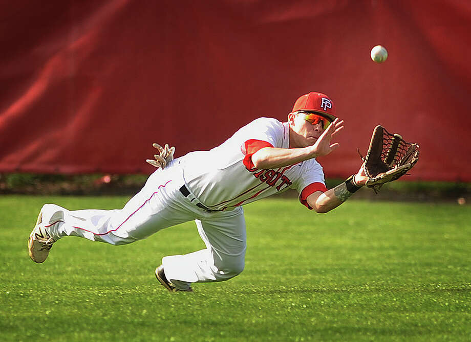 Fairfield Prep center fielder Joe Ganim makes a diving catch to end the fourth inning in the Jesuits' baseball game with Xavier at Fairfield University in Fairfield, Conn. on Monday, April 27, 2015. Photo: Brian A. Pounds / Connecticut Post