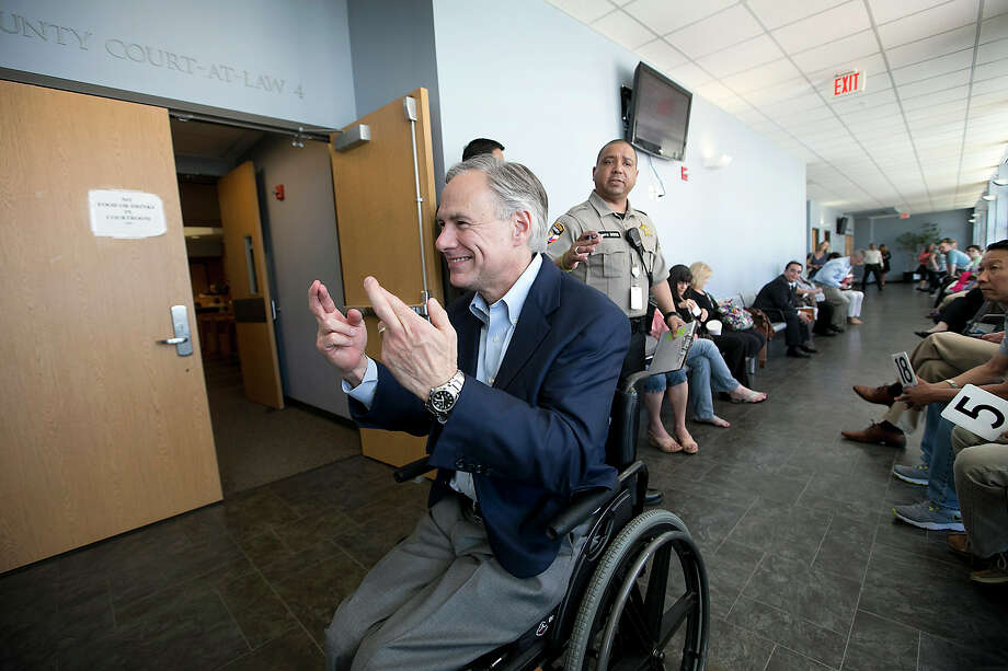 Texas Gov. Greg Abbott crosses his fingers Monday while awaiting jury selection at the Travis County Judicial Center in Austin. He is the third governor in a row to be summoned while in office, though none was picked for a jury. Photo: Ralph Barrera, MBO / Austin American-Statesman