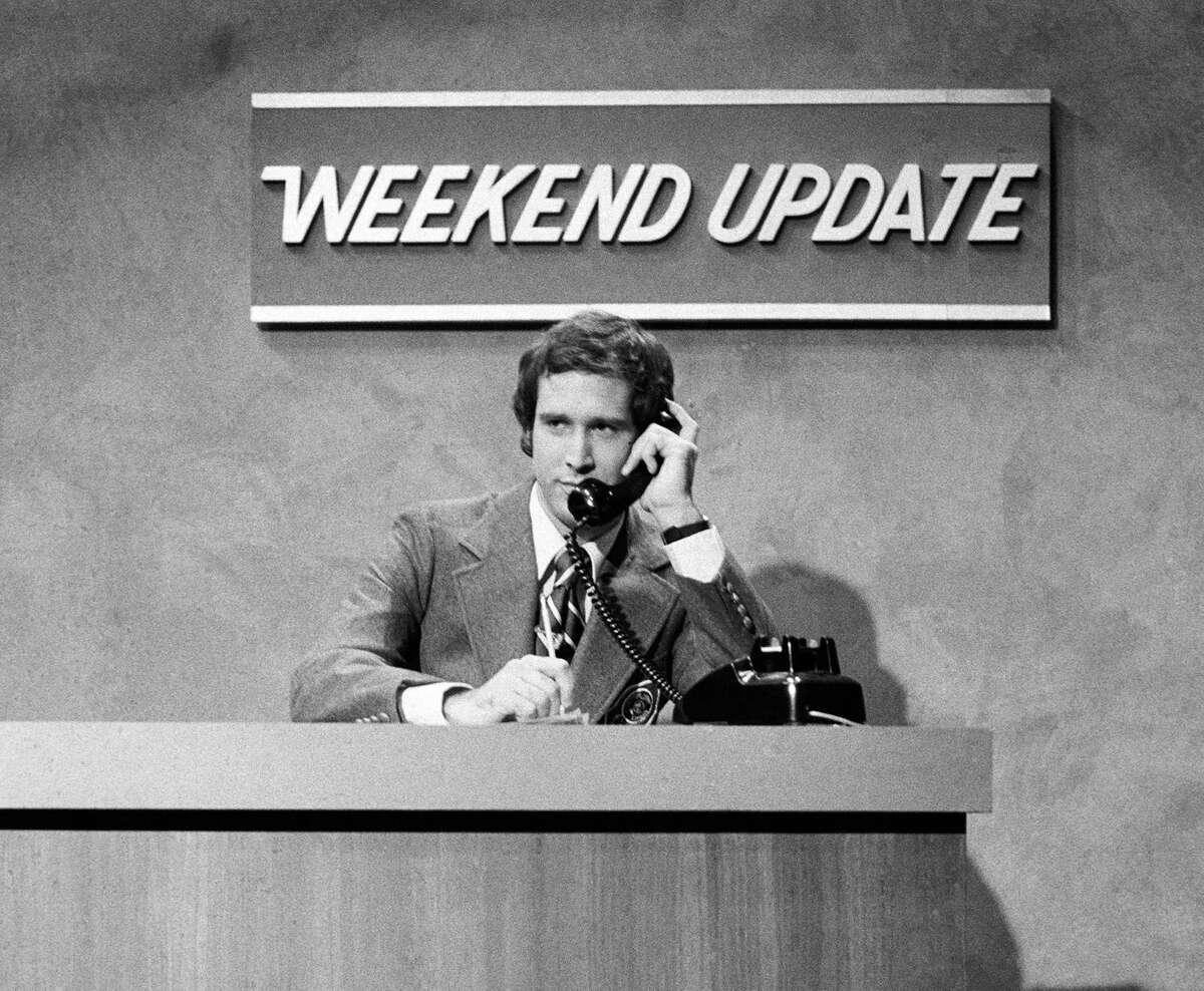 In this Oct. 11, 1975 photo released by NBC, Chevy Chase performs during a