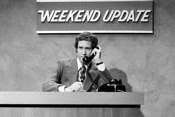 "In this Oct. 11, 1975 photo released by NBC, Chevy Chase performs during a ""Weekend Update"" sketch on ""Saturday Night Live,"" in New York. The long-running sketch comedy series will celebrate their 40th anniversary with a 3-hour special airing Sunday at 8 p.m. EST on NBC."