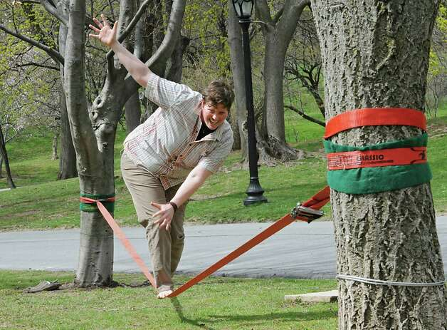 Kelsey Lane of Albany works on her slacklining skills in Washington Park on Monday, April 27, 2015 in Albany, N.Y.  She said it's like yoga in the air and works your core muscles. (Lori Van Buren / Times Union) Photo: Lori Van Buren