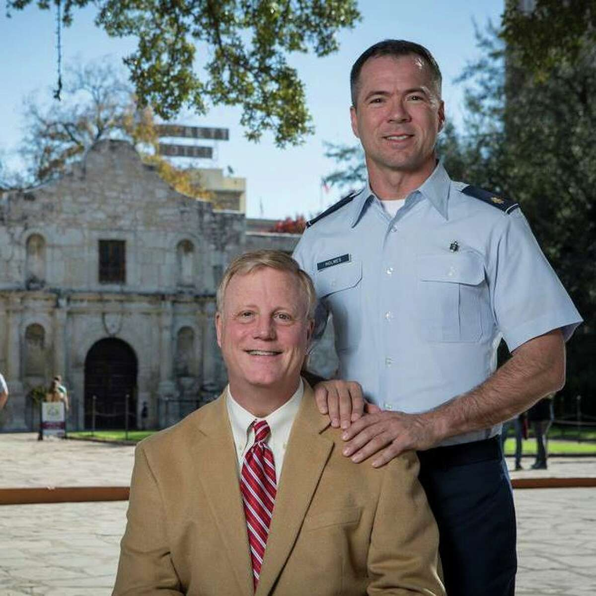 Mark Phariss and Victor Holmes, two of the four plaintiffs in the case challenging Texas' gay marriage ban, pose in front of the Alamo.
