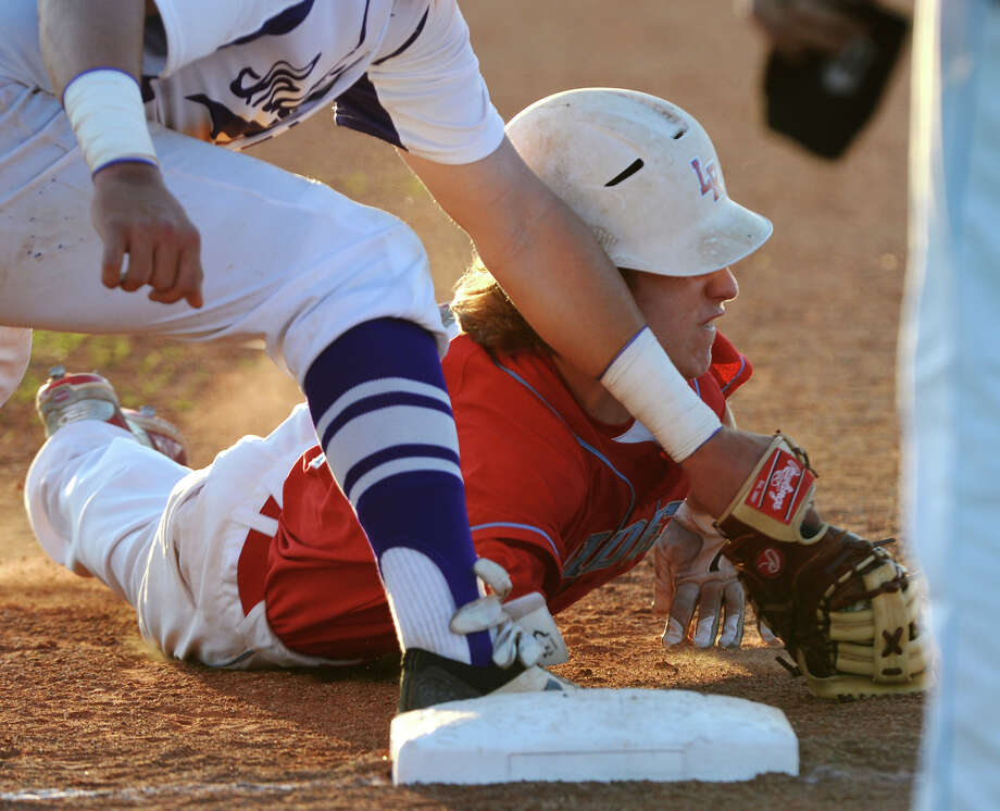 Port Neches-Groves' Adam Morse, No. 13, outs Lumberton's Lance Millican, No. 5, at first base Tuesday. The Port Neches-Groves Indians baseball team hosted the Lumberton Raiders on Tuesday evening. Photo taken Tuesday 3/24/15 Jake Daniels/The Enterprise Photo: Jake Daniels / ©2015 The Beaumont Enterprise/Jake Daniels