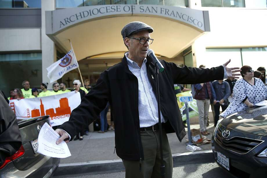 Sacred Heart Cathedral teacher Jim Jordan speaks as teachers and other unionized employees rally against Archbishop Salvatore Cordileone's planned morality clause for archdiocese school employees in front of Archdiocese headquarters in San Francisco, Calif., on Monday, April 27, 2015. Photo: Scott Strazzante, The Chronicle