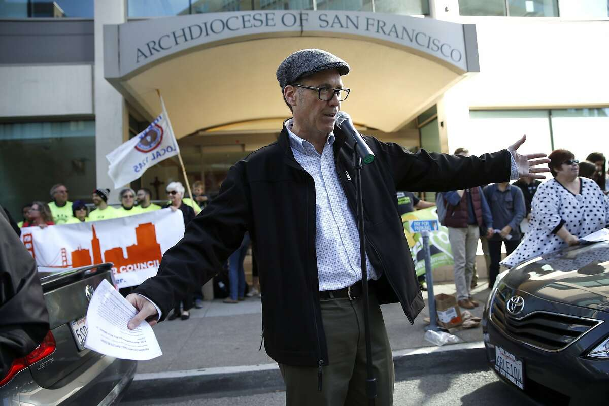 Sacred Heart Cathedral teacher Jim Jordan speaks as teachers and other unionized employees rally against Archbishop Salvatore Cordileone's planned morality clause for archdiocese school employees in front of Archdiocese headquarters in San Francisco, Calif., on Monday, April 27, 2015.