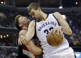 FILe - In this April 19, 2015, file photo, Memphis Grizzlies center Marc Gasol (33), of Spain, collides with Portland Trail Blazers center Meyers Leonard, left, during the second half of Game 1 of an NBA basketball Western Conference playoff series in Memphis, Tenn. Memphis is the midst of the best stretch in franchise history, including making its first Western Conference finals appearance in 2013. Now Gasol has helped the Grizzlies build a 2-0 lead in their opening series with Portland.  (AP Photo/Mark Humphrey, File)