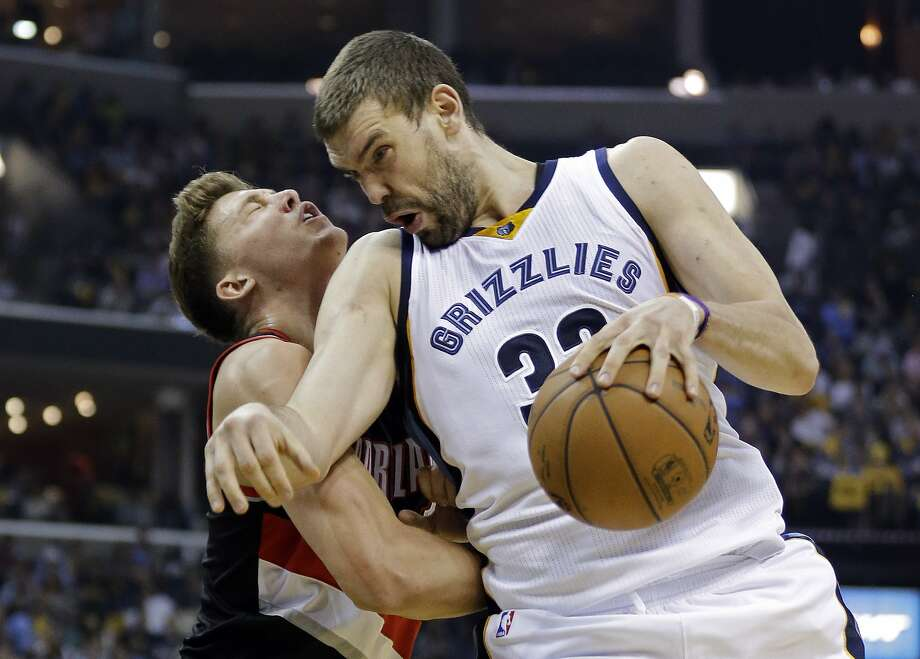 Marc Gasol (right) and the Memphis Grizzlies take pride in being one of the NBA's more physical teams. Photo: Mark Humphrey, Associated Press