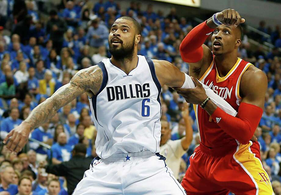 Tyson Chandler and Dwight Howard have had an intense battle in the paint throughout the first four games of their first-round playoff series. Photo: James Nielsen, Staff / © 2015  Houston Chronicle