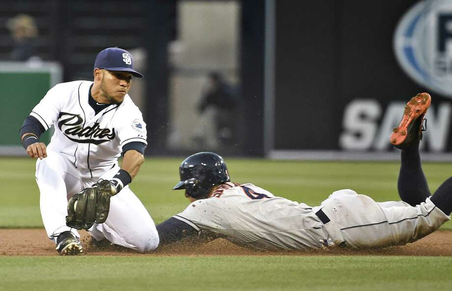 The Astros' George Springer steals second base ahead of the tag by the Padres' Alexi Amarista in the first inning of Monday night's game at San Diego. For a recap of the game, go to chron.com/sports. Photo: Denis Poroy, Stringer / 2015 Getty Images