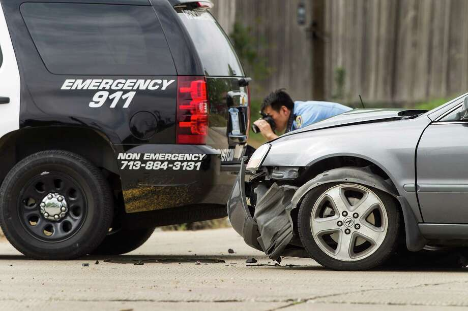 Police investigate the scene of an accident involving an officer Monday at the intersection of Airport and Linnet Lane. The officer was taken to the hospital. Photo: Brett Coomer, Staff / © 2015 Houston Chronicle