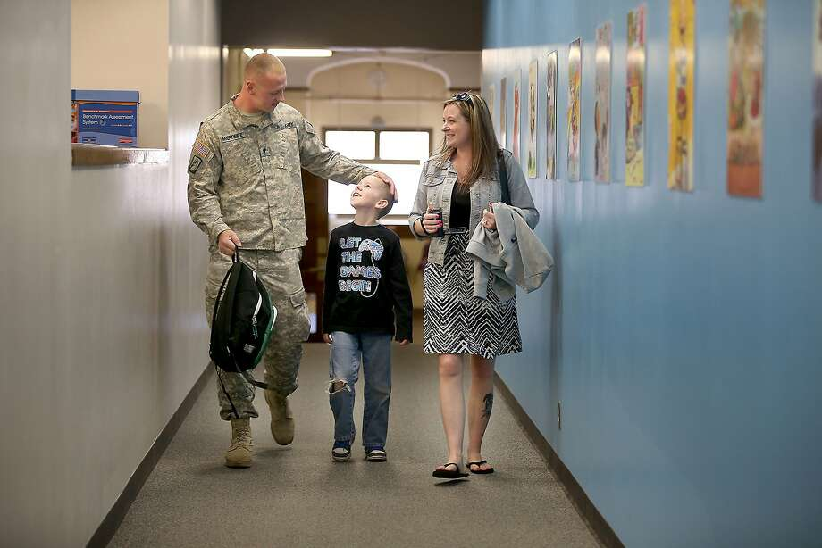 Hale Elementary School second grader Jaden Martinez is more than happy to be picked up by his father Jacob Martinez and his mother Cassandra Martinez after after his father surprised him in class on Monday, April 27, 2015 in Minneapolis, Minn. Martinez returned after a year in Kuwait and Iraq with the U.S. Army. Photo: Elizabeth Flores, McClatchy-Tribune News Service
