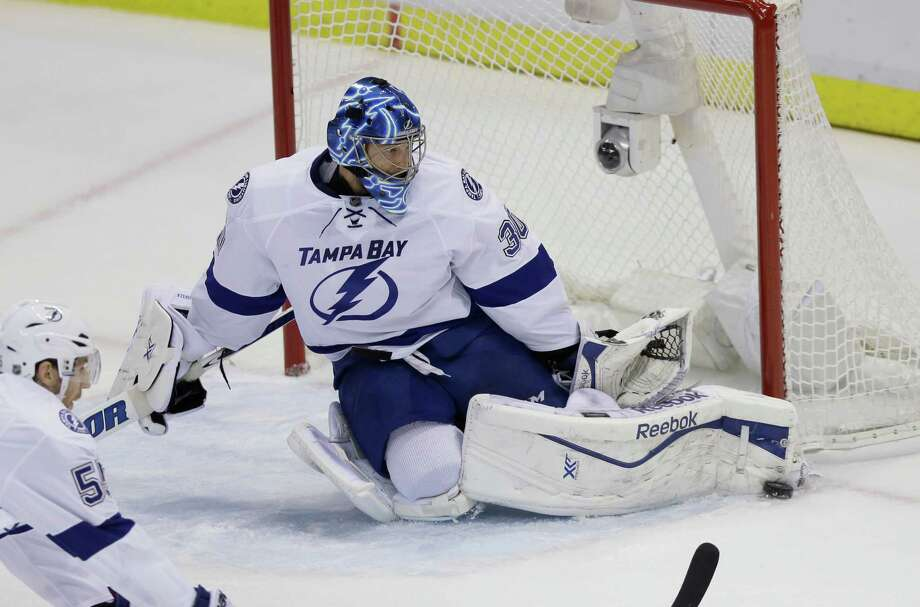 Tampa Bay Lightning goalie Ben Bishop makes a pad save during the second period of Game 6 of a first-round NHL Stanley Cup hockey playoff series against the Detroit Red Wings, Monday, April 27, 2015 in Detroit. (AP Photo/Carlos Osorio) ORG XMIT: MICO106 Photo: Carlos Osorio / AP
