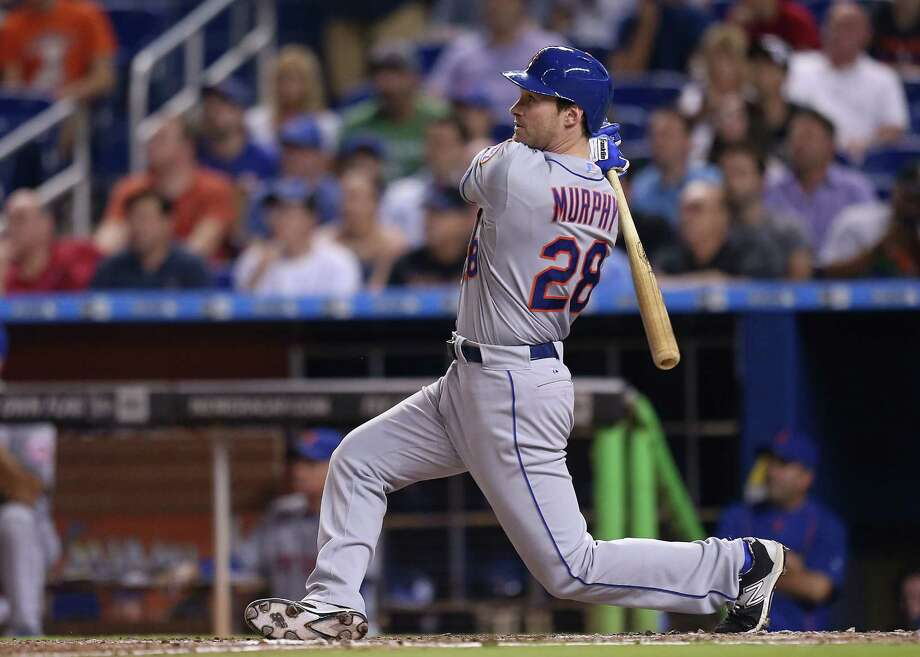 MIAMI, FL - APRIL 27: Daniel Murphy #28 of the New York Mets hits a three-run home run during the ninth inning of the game against the Miami Marlins at Marlins Park on April 27, 2015 in Miami, Florida.  (Photo by Rob Foldy/Getty Images) ORG XMIT: 538578215 Photo: Rob Foldy / 2015 Getty Images