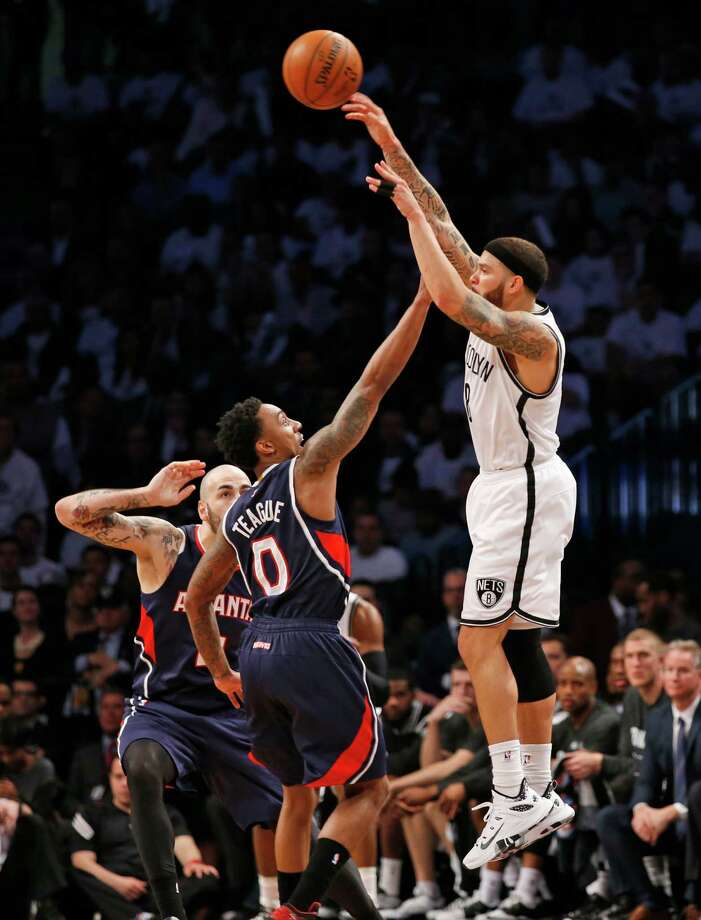 Brooklyn Nets guard Deron Williams (8) passes over Atlanta Hawks guard Jeff Teague (0) in the second half of Game 4 of a first round NBA playoff basketball game, Monday, April 27, 2015, in New York. (AP Photo/Kathy Willens) Photo: Kathy Willens, STF / AP