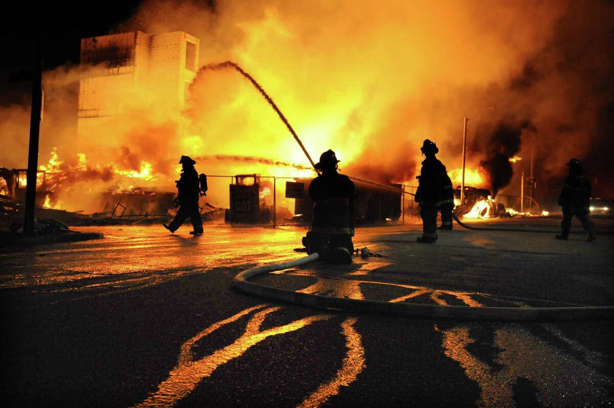 Baltimore firefighters battle a blaze at a senior living facility under construction during a night of rioting.