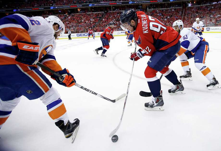 Washington Capitals center Evgeny Kuznetsov (92), from Russia, works the puck with New York Islanders left wing Josh Bailey (12) defending, during the first period of Game 7 in the first round of the NHL hockey Stanley Cup playoffs, Monday, April 27, 2015, in Washington. (AP Photo/Alex Brandon) ORG XMIT: VZN101 Photo: Alex Brandon / AP