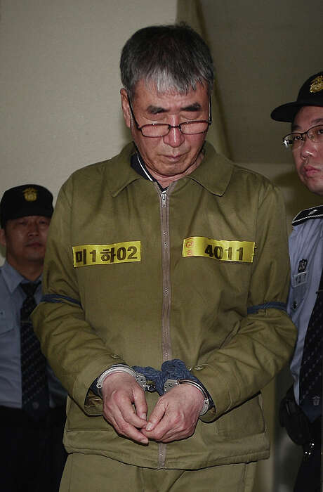 Lee Joon-seok, the captain of the sunken South Korean ferry Sewol, arrives for verdicts at Gwangju High Court in Gwangju, South Korea, Tuesday, April 28, 2015. The South Korean appellate court on Tuesday handed down a sentence of life in prison to Lee. The sentencing is harsher than a November verdict by a district court that sentenced Lee to 36 years in prison for negligence and abandoning passengers in need. (Park Chul-hong/Yonhap via AP) KOREA OUT Photo: Park Chul-hong, SUB / Yonhap