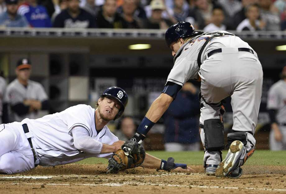 Astros catcher Jason Castro tags out the Padres' Wil Myers during the seventh inning Monday night. Photo: Denis Poroy, Stringer / 2015 Getty Images