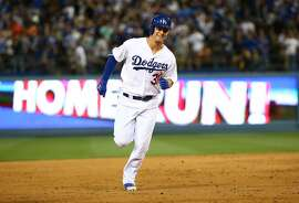 LOS ANGELES, CA - APRIL 27:  Joc Pederson #31 of the Los Angeles Dodgers smiles as he rounds the bases on his solo home run in the sixth inning against the San Francisco Giants during the MLB game at Dodger Stadium on April 27, 2015 in Los Angeles, California.  (Photo by Victor Decolongon/Getty Images)