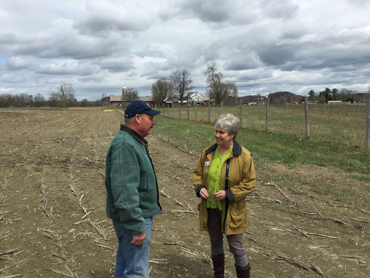 Farmer Jay Skellie and Teri Ptacek on the McArthur-Sauert Farm in Greenwich. Skellie farms here on the farm preserved by ASA from development. (Kenneth C. Crowe II / Times Union)