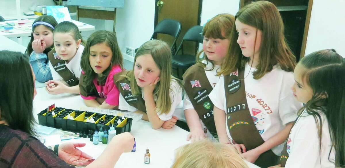 Brownies from New Milford Troop 40277 are eager listeners during their visit to Studio 25 and Creative Arts Studio. April 2015