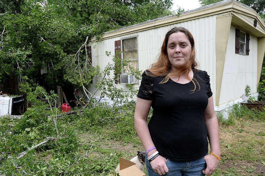 Tianna Morgan says she is grateful that the damage caused when a tree crashed onto her family's Jasper trailer home in Monday morning's storms spared injury to her children, including Ali, who is disabled due to a rare neuromuscular disorder. The family awoke to the sound of the large nearby tree hitting their home. The trunk and branches broke through the roof, landing within inches of Ali's bed and bringing down roofing onto her younger brother, who suffered minor scrapes. The family is in the process of moving into a new home and had a number of their belongings packed in a trailer outside the home. Among their most cherished belongings are the hundreds of letters Ali received from around the world on her last birthday.  Photo taken Monday, April 27, 2015  Kim Brent/The Enterprise Photo: Kim Brent / Beaumont Enterprise