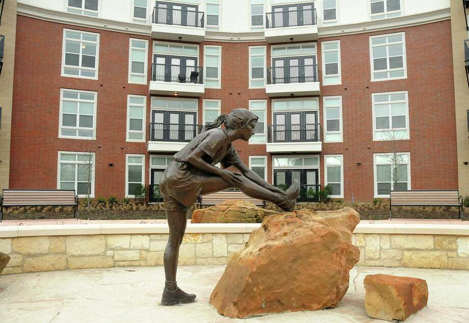 A sculpture welcomes visitors near the entrance to the Belvedere on Mossy Oaks luxury apartment complex in the Springwoods Village development. Photo: David Hopper, Freelance / freelance