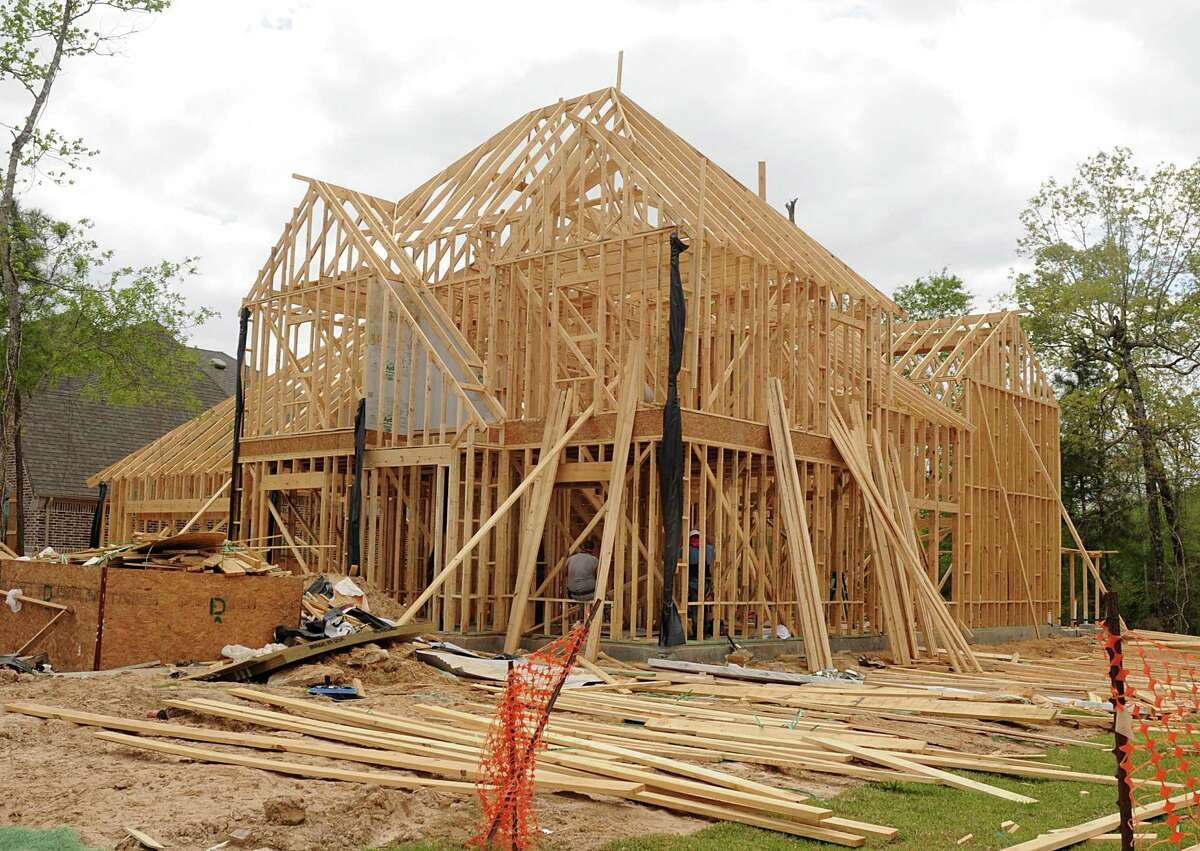 Framework construction continues on a house in the Woodforest community. The new 3,000-acre development, under construction north of The Woodlands, is growing by about 400 to 500 new home sales annually.