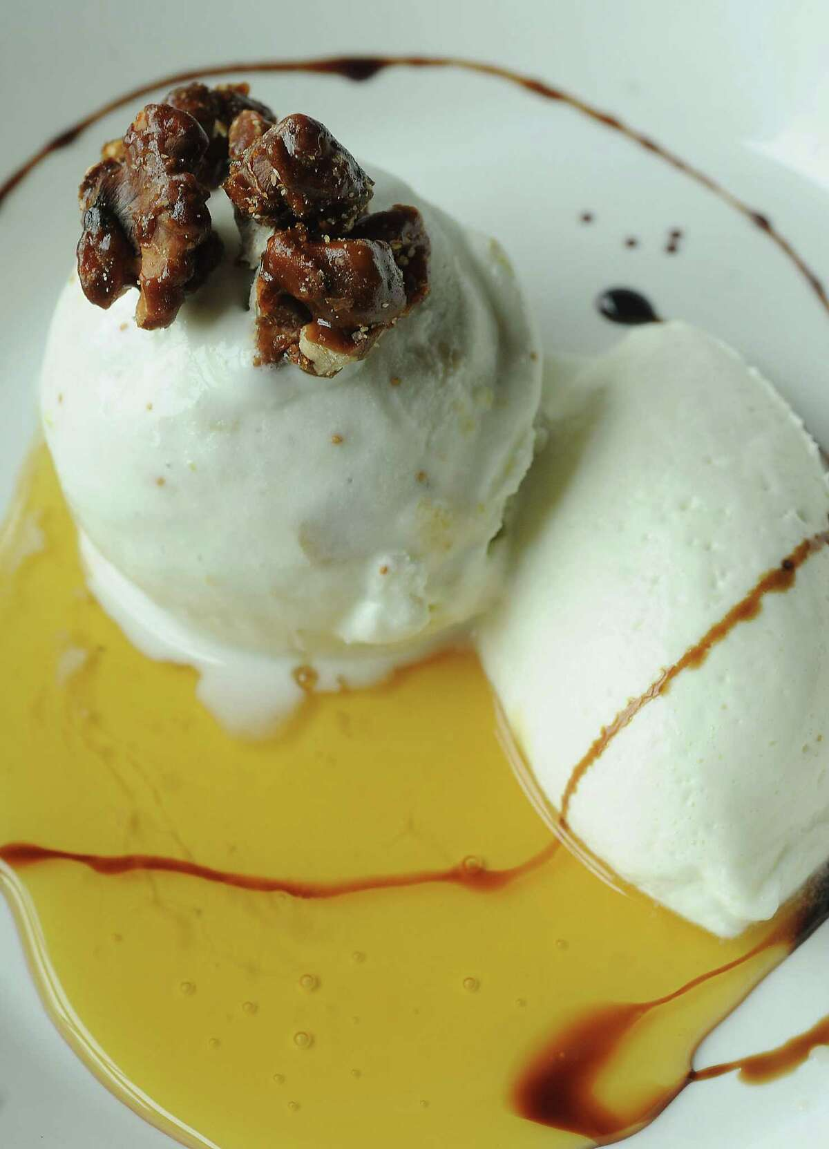 The fig gorgonzola dolce gelato with whipped cream, candied walnuts and honey at Weights & Measures Thursday April 23, 2015.(Dave Rossman photo)