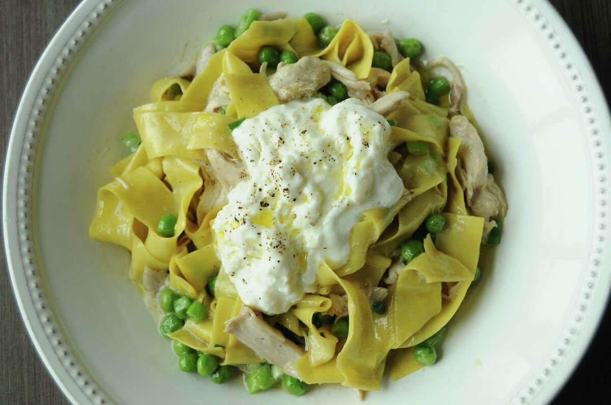 The confit rabbit with homemade papparedelle, fresh peas, scallions and buratta cheese at Weights & Measures Thursday April 23, 2015.(Dave Rossman photo)