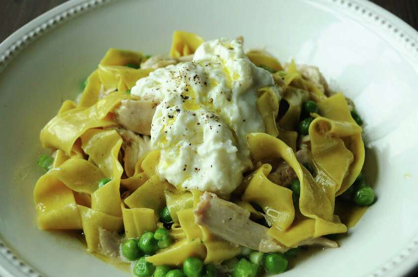 The confit rabbit with homemade papparedelle, fresh peas, scallions and buratta cheese at Weights & Measures.